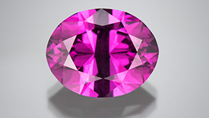 Color-change pyrope garnet cut by Victor Tuzlukov.