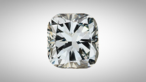 A face-up view of a cushion cut diamond with blue color.
