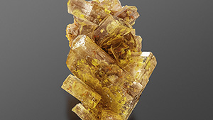 Bright yellow inclusions inside barite crystals.