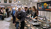 Crowded booth at AGTA gem show.
