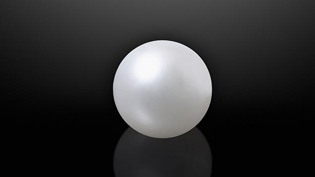 White round nacreous pearl.