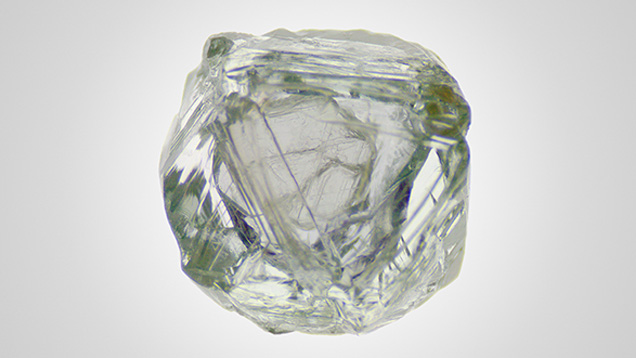 Small hexagonal diamond crystal enclosed in the cavity.