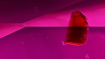 Brownish red staurolite crystal in ruby host.