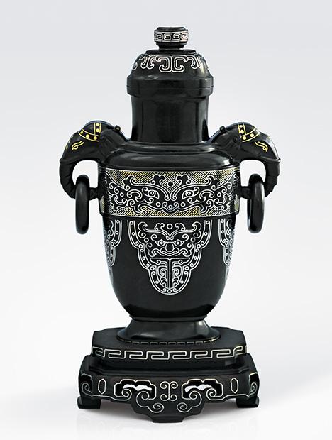 Dark gray nephrite vessel showcases elaborate gold inlay.