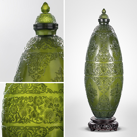 Eggshell-thin dark green nephrite vase is decorated with lotus branches.