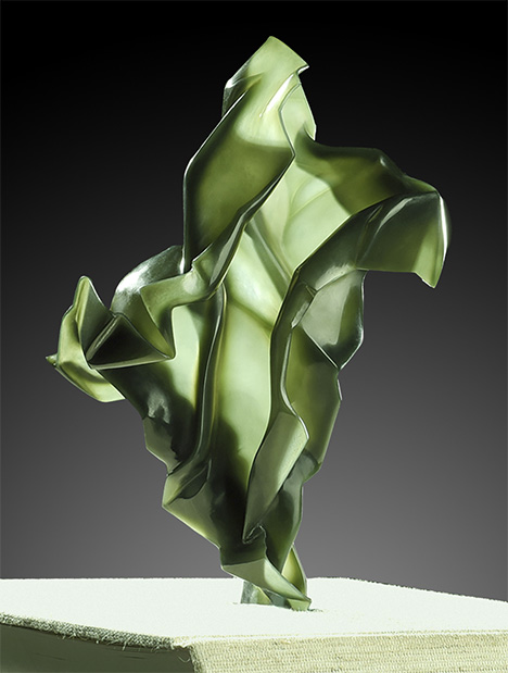 Eggshell carving showcases the transparent feel of creased paper in this nephrite work of art.
