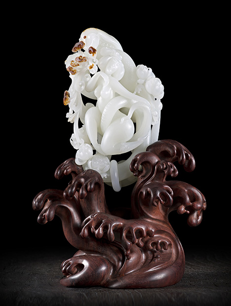 """Openwork and Qiaose crafts are utilized in this white nephrite jade carving titled """"Snake Girl."""""""
