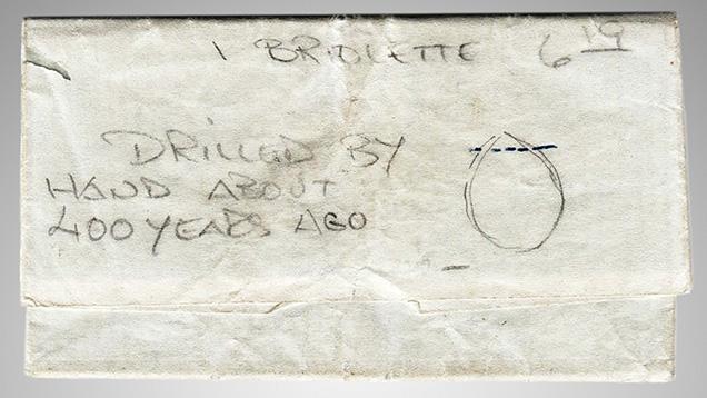 Diamond paper containing the briolette.