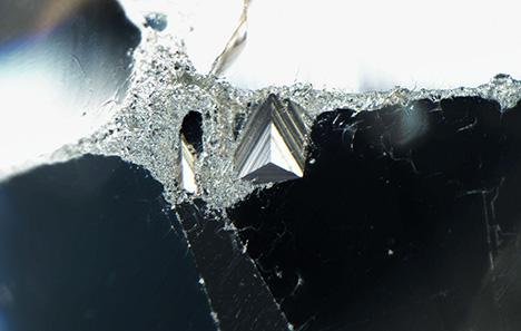 The original crystal surface seen as a trigon.