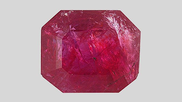 This 12.12 ct stone showed features associated with natural ruby.