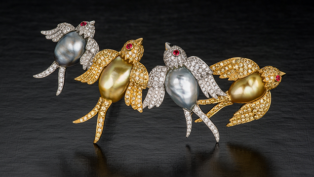 "Brooch depicting swallows featuring ""keshi"" cultured pearls, along with diamonds and rubies."