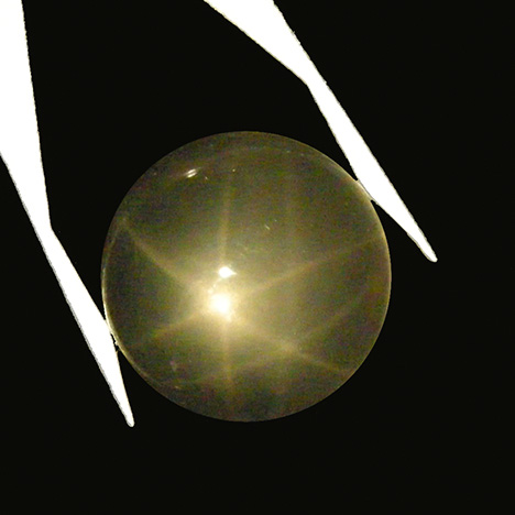 Very light rose quartz cabochon from Brazil showing double stars in reflected light