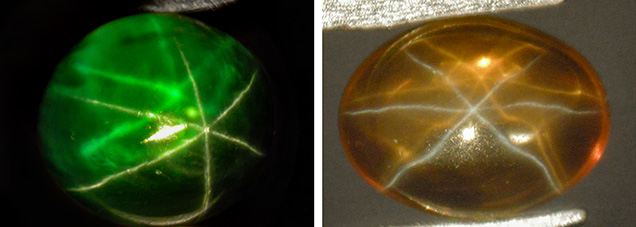 A green and an orange synthetic sapphire cabochon, both with dual-color double asterism