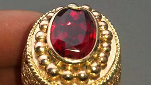 Bright red faceted ruby in a gold ring, from the large and potentially productive Snezhnoe deposit in Tajikistan.