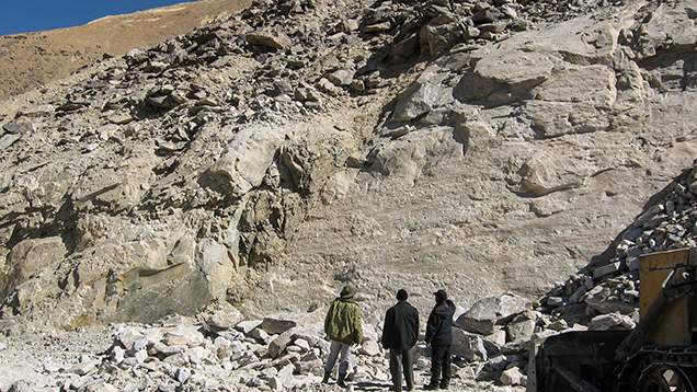 An outcrop of white marble and dumps at the corundum deposit in Snezhnoe, Tajikistan.