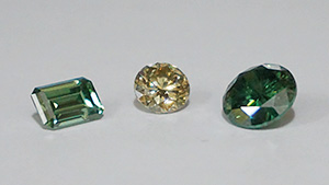 Synthetic moissanite imitating synthetic colored diamonds.