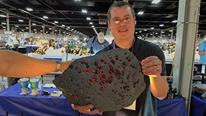 Jason Baskin with almandine in graphite schist.