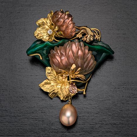 Pin/pendant with sunstone, pearl, diamond, chalcedony, and zircon.