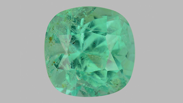 Emerald with two drill holes
