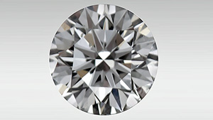 Round brilliant diamond showing bright red fluorescence.