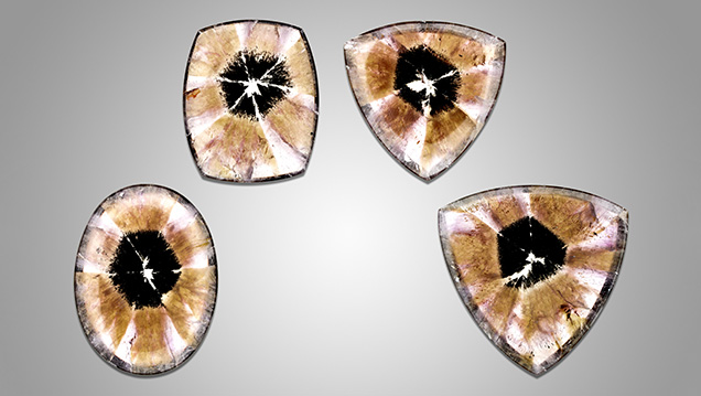Four trapiche-like amethyst cabochons.