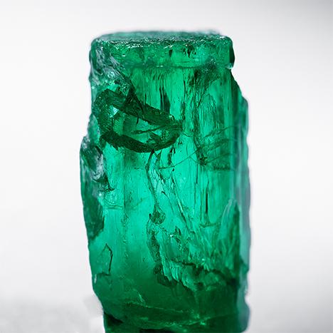 Emerald inclusion inside a large emerald specimen.