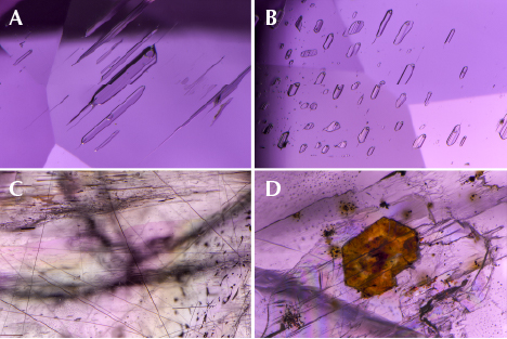 Fluid inclusions, rutile needles, and a crystal in purplish pink diaspore.