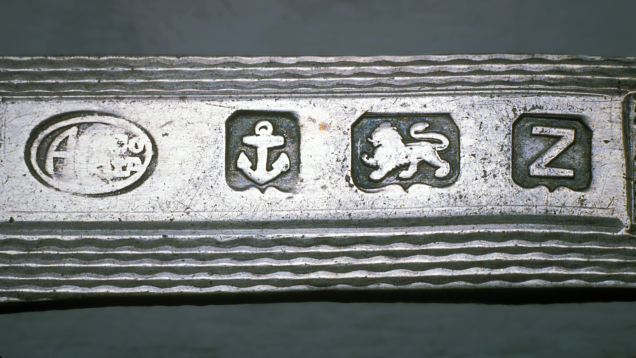A piece of jewelry showing hallmarks