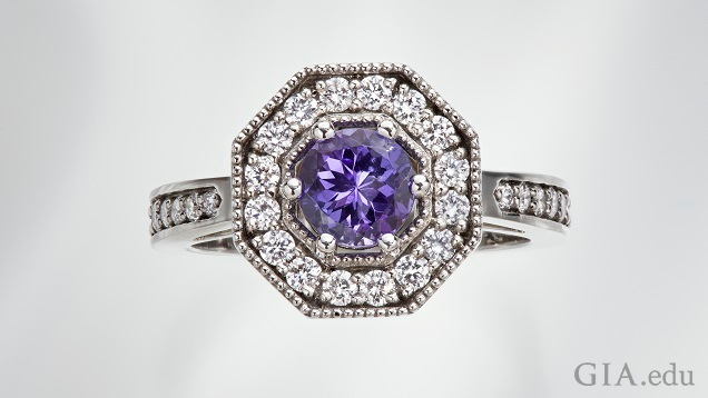 The tanzanite center stone is framed by diamonds in an octagonal frame.