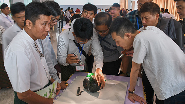 Buyers were checking the quality of a jadeite boulder
