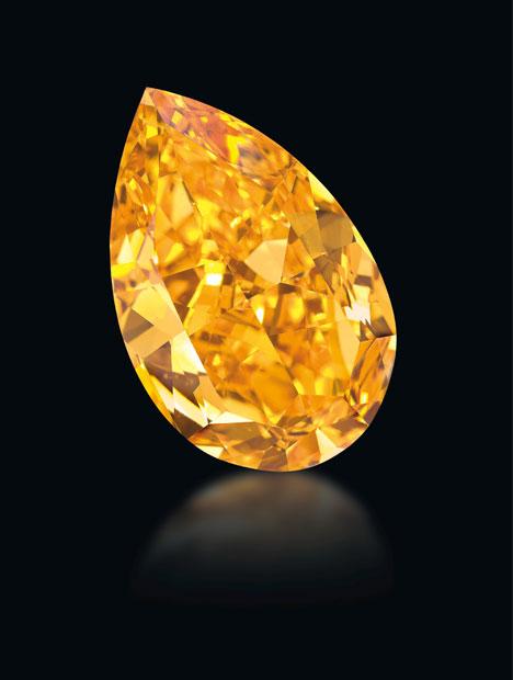 The Orange, a GIA-graded 14.82 carat fancy vivid orange diamond, sold for $35.5 million at a Christie's auction Nov.11, 2013 in Geneva. Photo courtesy of Denis Hayoun Diode SA Geneva