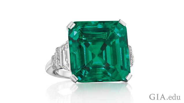 The Rockefeller Emerald is an 18.04 ct octagonal step cut emerald set in a ring and flanked by diamonds.