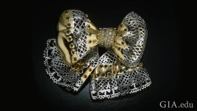 The bow section and ribbon tendrils are made from two metals – silver and gold colored.