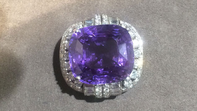 A 50.09 ct. purple-to-violet sapphire set in a ring.