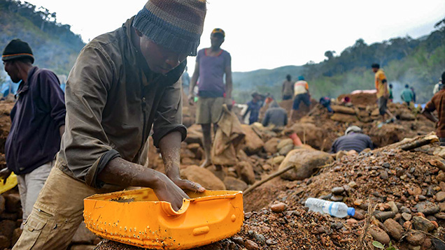 Malagasy miner in search of rubies.