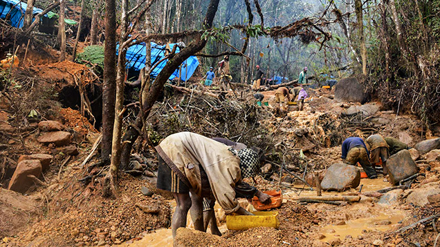 Malagasy miners washing gem-rich gravels.