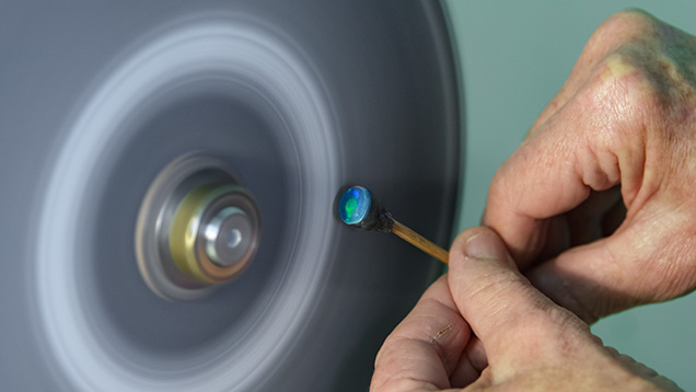 Polishing an opal cabochon