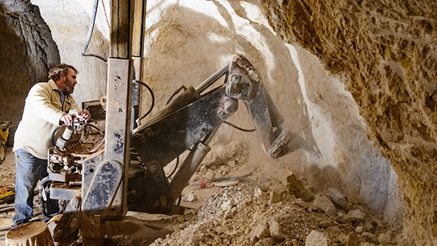 A customized digger removes opal-bearing clay