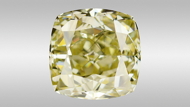 Fancy brownish greenish yellow diamond with octahedral-shaped inclusion.