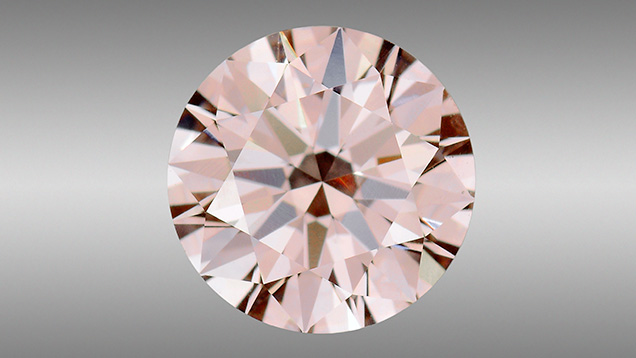 Natural Fancy pink diamond with apparent HPHT synthetic growth structure.