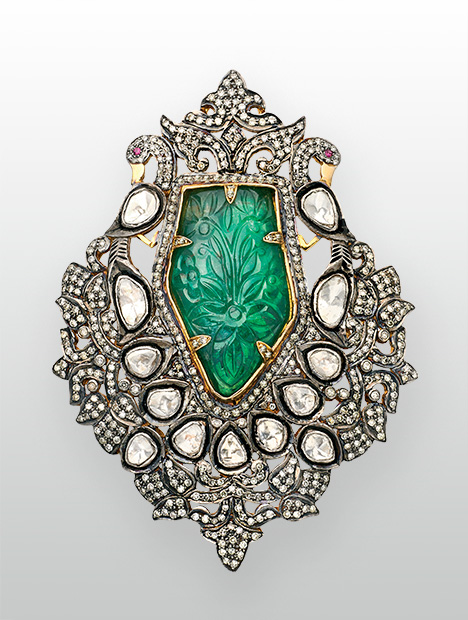 Peacock brooch featuring Zambian emerald