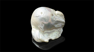"This 20.60 ct specimen was purchased by the client as a ""natural white pearl."""