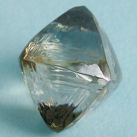 Synthetic moissanite coated with a diamond film