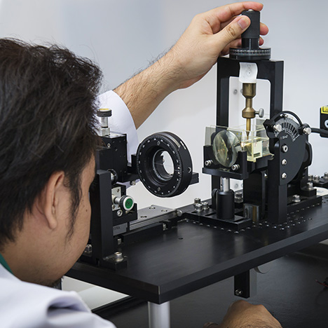 Gemologists use a custom-built instrument to align samples along their c-axis