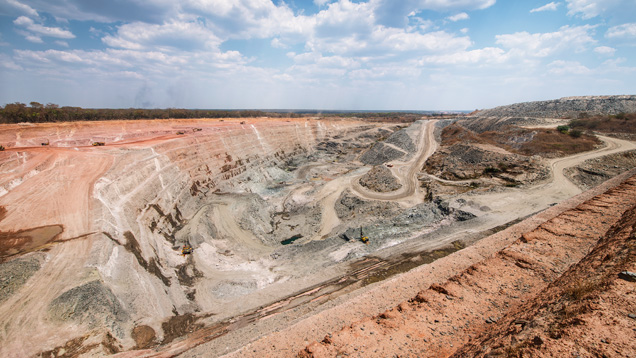 Emerald mining in Zambia features massive open pits