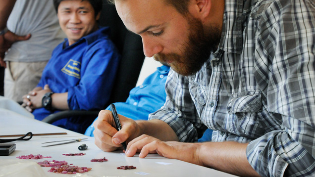 Field gemologist selects rubies in Mozambique