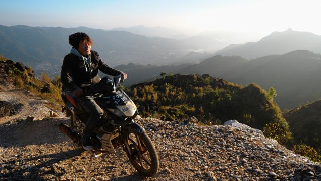 Artisanal miner on motorbike in Myanmar