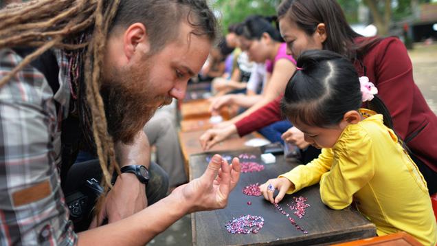 Field gemologist checks spinel at Vietnamese market
