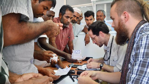 Field gemologist inspects sapphires in Sri Lanka