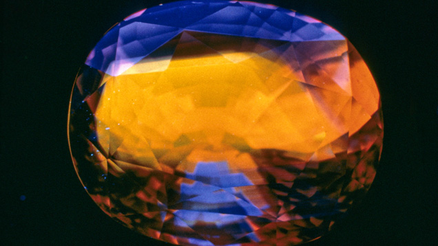 Orange fluorescence in blue sapphire